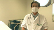 MS OF A DOCTOR WEARING A SURGICAL MASK AND GLOVES Stock Footage