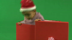 ZO LS OF A BABY STANDING IN A BOX Stock Footage