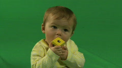 MS OF A BABY CHEWING ON A BUILDING BLOCK - stock footage