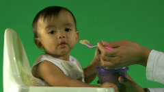 MS OF A BABY BEING FED Stock Footage