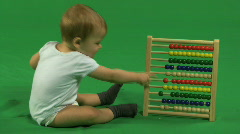 LS OF A BABY PLAYING WITH AN ABACUS Stock Footage