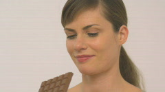 MCU OF A WOMAN EATING CHOCOLATE Stock Footage