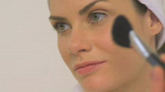 BCU OF A WOMAN APPLYING BLUSHER - stock footage