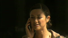 MCU OF A BUSINESSWOMAN USING A CELL PHONE Stock Footage