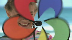 CU OF A GIRL SPINNING A PIN WHEEL Stock Footage