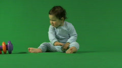 LS OF A BABY PLAYING WITH TOYS Stock Footage