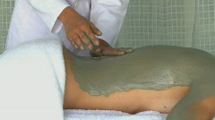 MS PAN OF A WOMAN HAVING A BODY MASK IN SPA Stock Footage