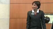 MS OF A BUSINESSWOMAN GREETING A CLIENT Stock Footage