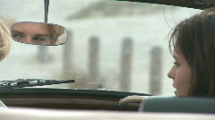 CU OF A YOUNG COUPLE SAT IN A CAR Stock Footage