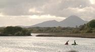 2 canoes on Irish lake Stock Footage