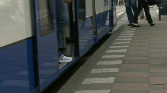 TIMELAPSE OF PEOPLE GETTING OFF A TRAM IN AMSTERDAM Stock Footage