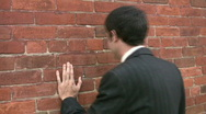 Man bangs head against wall. Stock Footage
