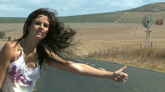 MS OF A YOUNG WOMAN HITCHHIKING Stock Footage