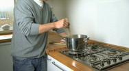 Stock Video Footage of MS OF A MAN STIRRING PASTA