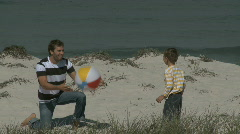 MS OF A FATHER AND SON THROWING A BALL TO EACH OTHER Stock Footage