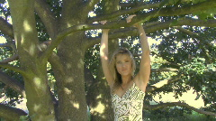 MS OF A WOMAN HANGING FROM A TREE Stock Footage