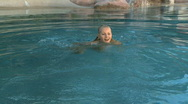 Stock Video Footage of MS OF A WOMAN SWIMMING IN A POOL AT SPA