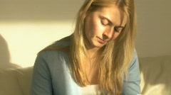 CU PAN OF A YOUNG WOMAN SORTING OUT HER FINANCES Stock Footage