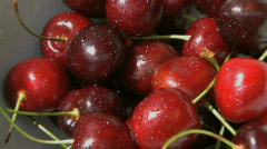 WS BOWL OF CHERRY'S ON GARDEN TABLE Stock Footage