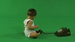 LS OF A BABY PLAYING WITH A TELEPHONE Stock Footage