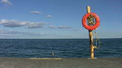 Lifering on pier. Stock Footage