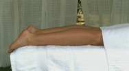 Stock Video Footage of MS PAN OF A WOMAN HAVING A MASSAGE IN SPA