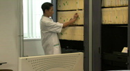 LS MS ZI OF A DOCTOR USING A COMPUTER Stock Footage