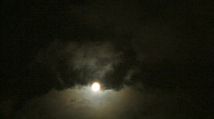 Clouds moving at full moon Stock Footage