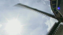 CU PAN LOW ANGLE VIEW OF A WINDMILL Stock Footage