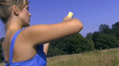 MS OF WOMAN APPLYING SUNCREAM Stock Footage