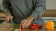 Stock Video Footage of MS OF A MAN CHOPPING PEPPERS