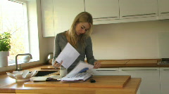 WS OF A YOUNG WOMAN SORTING OUT HER FINANCES Stock Footage
