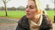 WS OF A YOUNG WOMAN IN A PARK Stock Footage