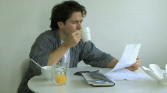 MS PAN MAN READING PAPER WORK Stock Footage