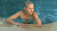 Stock Video Footage of MS OF A WOMAN IN A SWIMMING POOL