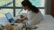 LS PAN OF A BUSINESSWOMAN WORKING IN HER HOTEL ROOM Stock Footage