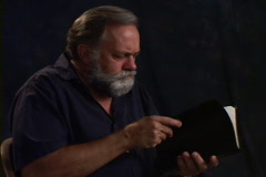 Man Reading Bible Stock Footage