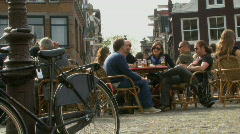 LS OF PEOPLE RELAXING AND DRINKING IN LELIEGRACHT Stock Footage