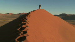 Lone figure, Sand Dunes, Namibia - stock footage