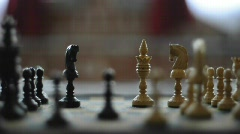 Queen takes bishop in chess game - stock footage