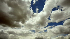 Cumulus clouds receding from camera Stock Footage