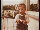 Boy with toy car on balcony (vintage 8 mm amateur film) Stock Footage