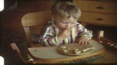Baby eating bread (vintage 8 mm amateur film) Stock Footage