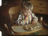 Stock Video Footage of Baby eating bread (vintage 8 mm amateur film)