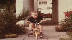 Boy riding trike (vintage 8 mm amateur film) Stock Footage