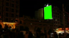 Blank billboard on the wall / crowded street / night / green screen Stock Footage