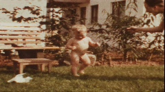Mother teases baby with water pistol (vintage 8 mm amateur film) Stock Footage