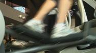 Feet walk on crosstrainer Stock Footage