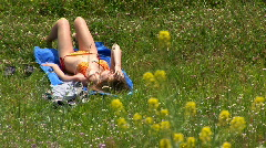 girl sunbathing - stock footage