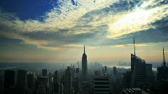 Empire State Building with sunbeams time lapse Stock Footage